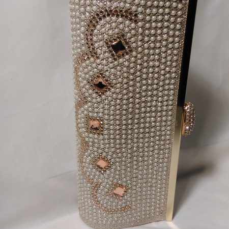Champagne and Gold clutch bag with pearl and sparkle detail.